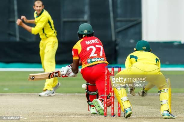 Zimbabwe's batsman Solomon Mire plays a reverse sweep shot past Australian wicketkeeper Alex Carey during the sixth T20 cricket match between...