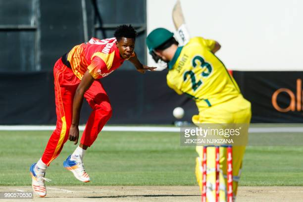 Zimbabwe's bolwer Blessing Muzarabani plays a shot during the third match played between Australia and hosts Zimbabwe as part of a T20 triseries...