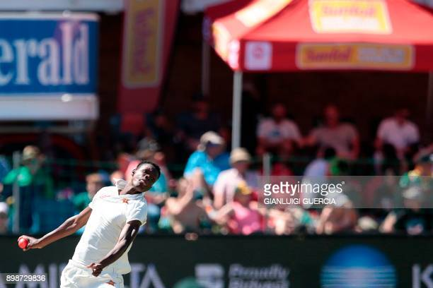 Zimbabwe's bowler Blessing Muzarabani bowls during the first day of the day night Test cricket match between South Africa and Zimbabwe at St George's...
