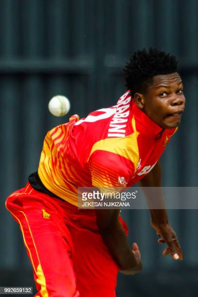 Zimbabwe's bowler Blessing Muzarabani delivers the ball during the sixth T20 cricket match between Australia and host nation Zimbabwe part of a T20...