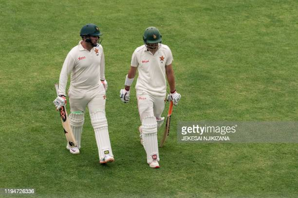 Zimbabwe's Brendan Taylor and Zimbabwe's Craig Ervine walks back to the pavilion at the end of play on the first day of the first Test cricket match...