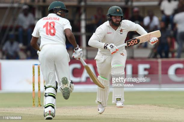 Zimbabwe's Brendan Taylor and Zimbabwe's Timycen Maruma runs between the wickets during the fourth day of the second Test cricket match between...