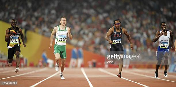 Zimbabwe's Brian Dzingai Ireland's Paul Hession Walter Dix of the US and Britain's Christian Malcolm compete in the men's 200m semifinal 1 at the...