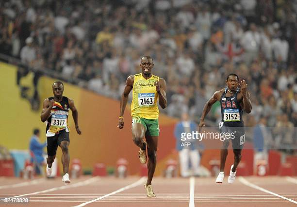 Zimbabwe's Brian Dzingai Jamaica's Usain Bolt and Shawn Crawford of the US compete in the men's 200m final at the Bird's Nest National Stadium during...