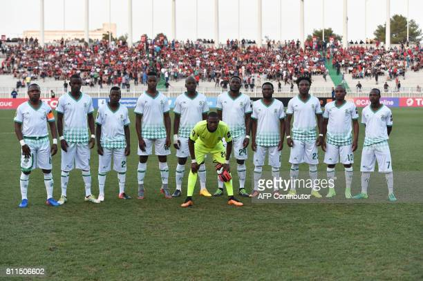 CORRECTION Zimbabwe's Caps United players pose for a group picture prior to the CAF Champions League group stage football match between USM Alger and...