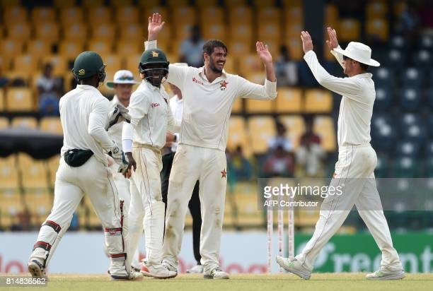 Zimbabwe's captain Graeme Cremer celebrates with his teammates after he dismissed Sri Lankan cricketer Niroshan Dickwella during the Second day of...