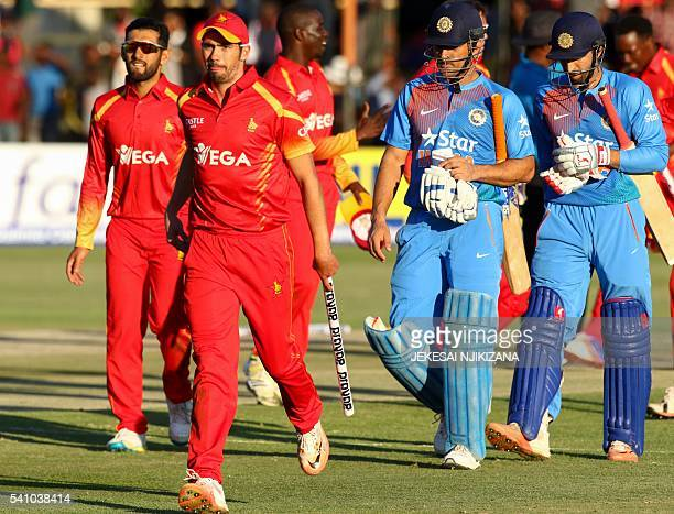 Zimbabwe's captain Graeme Cremer with stump in hand celebrates victory during the first T20 cricket match in a series of three games between India...