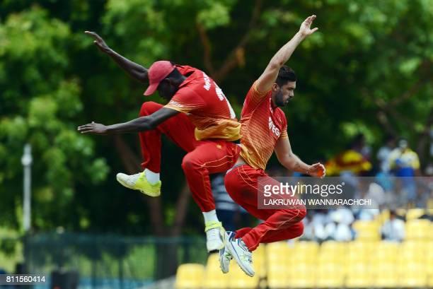 Zimbabwe's cricket captain Graeme Creme celebrates teammate Chris Mpofu after he dismissed Sri Lankan cricket captain Angelo Mathews during the fifth...