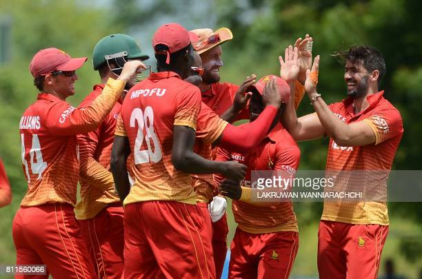 Zimbabwe's cricket captain Graeme Creme celebrates with his teammates after he dismissed Sri Lankan cricket captain Angelo Mathews during the fifth...