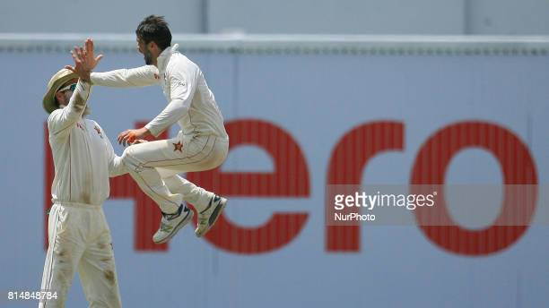 Zimbabwe's cricket captain Graeme Cremer right celebrates the dismissal of Sri Lanka's Kusal Mendis during the 2nd day's play of the only test...