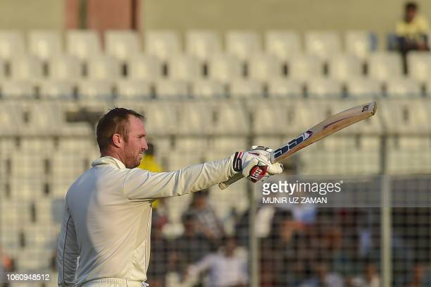 Zimbabwe's cricketer Brendan Taylor reacts after scoring a century during the third day of the second Test cricket match between Bangladesh and...