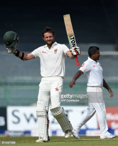 Zimbabwe's cricketer Craig Ervine celebrates after scoring a century during the first day of the only oneoff Test match between Sri Lanka and...