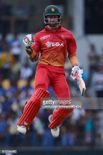 Zimbabwe's cricketer Craig Ervine celebrates after victory in the fourth oneday international cricket match between Sri Lanka and Zimbabwe at the...