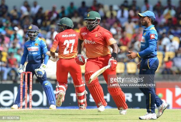 Zimbabwe's cricketer Hamilton Masakadza and teammate Solomon Mire run between wickets during the fifth oneday international cricket match between Sri...