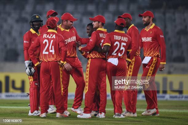 Zimbabwe's cricketers celebrate the dismissal of Bangladesh's Tamim Iqbal during the first Twenty20 international cricket match of a two-match series...
