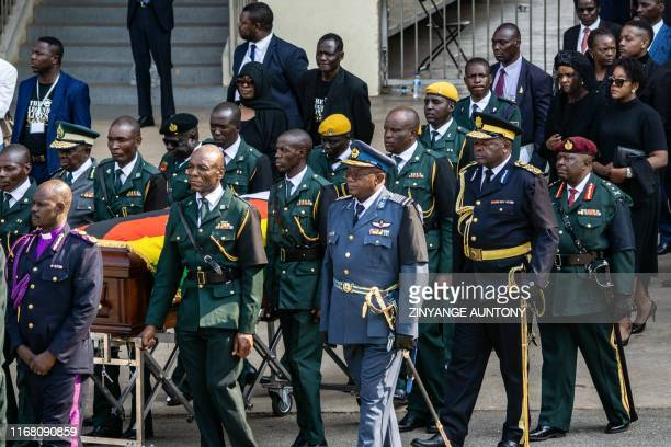 Zimbabwe's First Lady Grace Mugabe her daughter Bona Mugabe Chikore and son Bellermine Chatunga Mugabe follow pallbearers carrying the casket after...