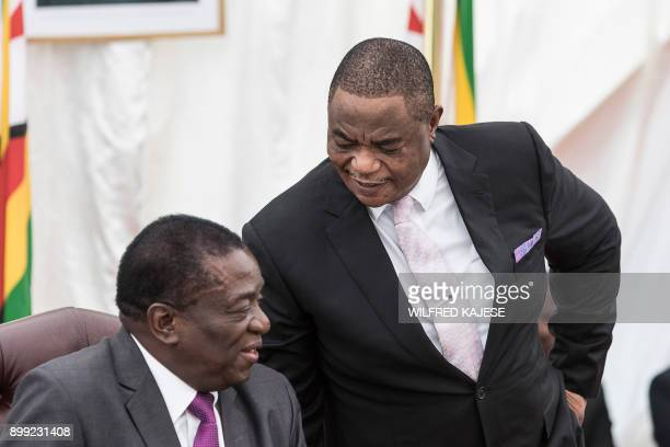 Zimbabwes former army commander and newly appointed vice president General Constantino Chiwenga and Zimbabwe's president Emmerson Mnangagwa speak...