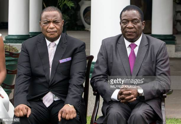 Zimbabwes former army commander and newly appointed vice president General Constantino Chiwenga and Zimbabwe's president Emmerson Mnangagwa sit as...
