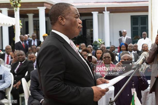 Zimbabwes former army commander and newly appointed vice president General Constantino Chiwenga takes the oath of office during the swearingin...