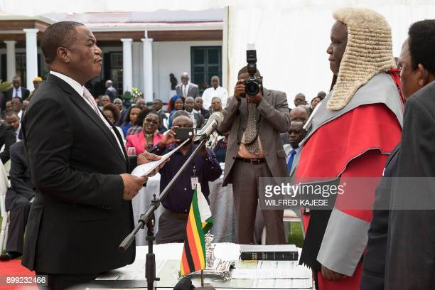 Zimbabwes former army commander and newly appointed vice president General Constantino Chiwenga takes the oath of office in front of Chief Justice...