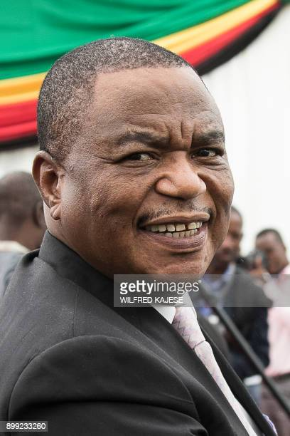 Zimbabwes former army commander and newly appointed vice president General Constantino Chiwenga looks on during the swearingin ceremony in Harare on...
