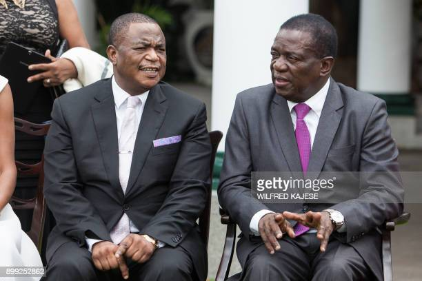 Zimbabwes former army commander and newly appointed vice president General Constantino Chiwenga and Zimbabwe's president Emmerson Mnangagwa sit and...