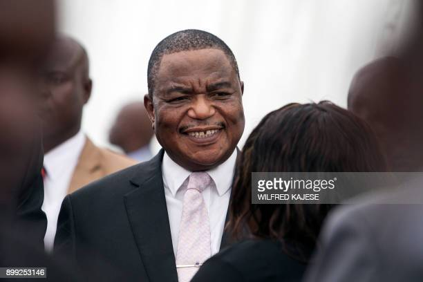 Zimbabwes former army commander and newly appointed vice president General Constantino Chiwenga reacts as he looks on during the swearingin ceremony...