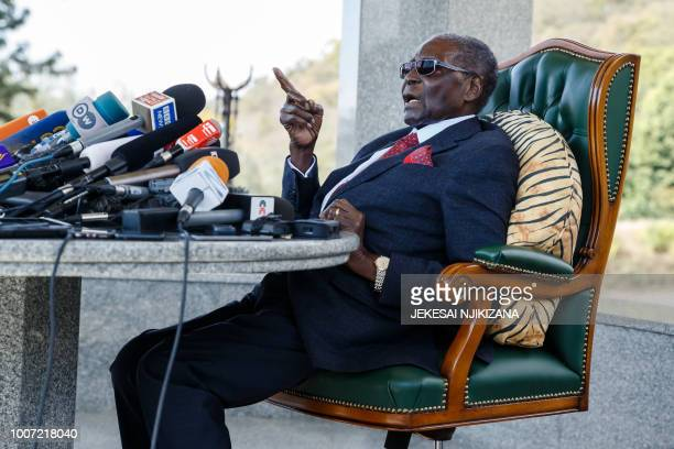 TOPSHOT Zimbabwe's former President Robert Mugabe speaks during a press conference held at his Blue Roof residence in Harare on July 29 2018 Zimbabwe...