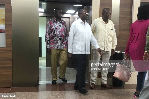 TOPSHOT Zimbabwe's former president Robert Mugabe walks out of a lift at the Gleneagles Hospital in Singapore on December 15 2017 Mugabe who was...
