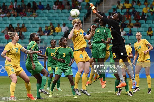 Zimbabwe's goalkeeper Lindiwe Magwede vies for the ball with Clare Polkinghorne of Australia during their Rio 2016 Olympic Games womens first round...