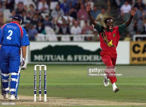 Zimbabwe's Henry Olonga celebrates the wicket of England's Chris Adams, during their One Day International at the Newlands Cricket ground, Cape Town,...