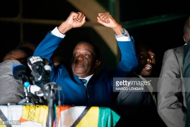 Zimbabwe's incoming president Emmerson Mnangagwa gestures as he speaks to supporters at Zimbabwe's ruling ZanuPF party headquarters in Harare on...