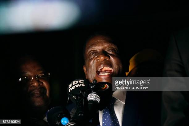 Zimbabwe's incoming president Emmerson Mnangagwa speaks at Zimbabwe's ruling ZanuPF party headquarters in Harare on November 22 2017 Zimbabwe's...
