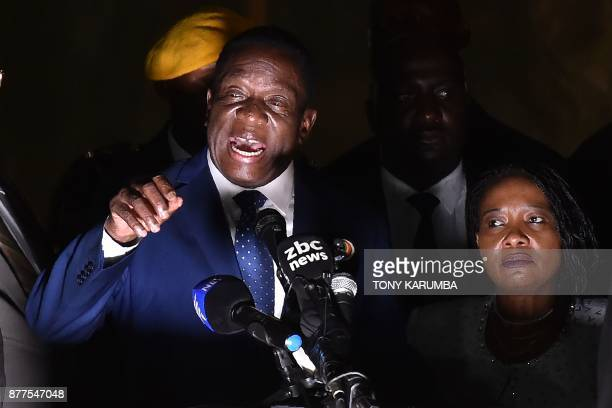 Zimbabwe's incoming president Emmerson Mnangagwa speaks to supporters flanked by his wife Auxilia at Zimbabwe's ruling ZanuPF party headquarters in...