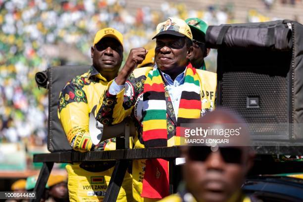 Zimbabwe's incumbent President and candidate Emmerson Mnangagwa arrives for his closing presidential campaign rally in Harare, on July 28 two days...