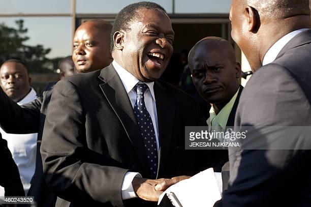 Zimbabwe's Justice Minister Emmerson Mnangagwa is congratulated after being appointed as Zimbabwe's vicepresident by President Robert Mugabe on...