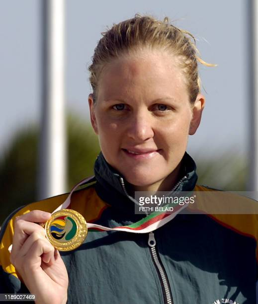 Zimbabwe's Kirsty Coventry poses with a gold medal 14 July 2007 after the women's 100m swimming backstroke event at the 9th AllAfricanGames 2007 in...