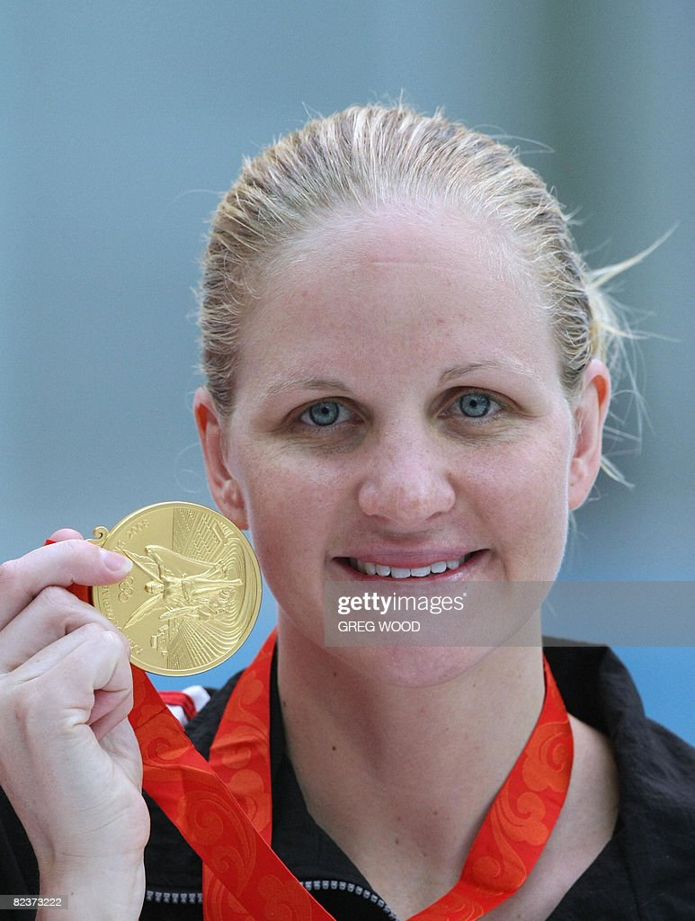 Zimbabwe's Kirsty Coventry stands on the : News Photo