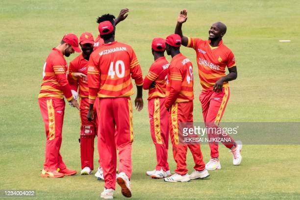 Zimbabwe's Luke Jongwe joins his team mates to in celebrating a wicket during the first ODI cricket match between Bangladesh and hosts Zimbabwe...
