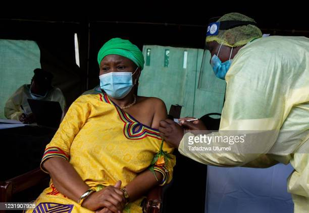 Zimbabwe's Minister of Defence Oppah Muchinguri Kashiri receives her first first dose of the Sinovac COVID-19 vaccine on March 24, 2021 in Victoria...