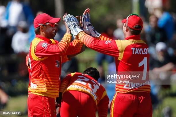 Zimbabwe's players celebrate after South Africa's Aiden Markram was dismissed by Brendan Taylor and Donald Tiripano during the second One Day...