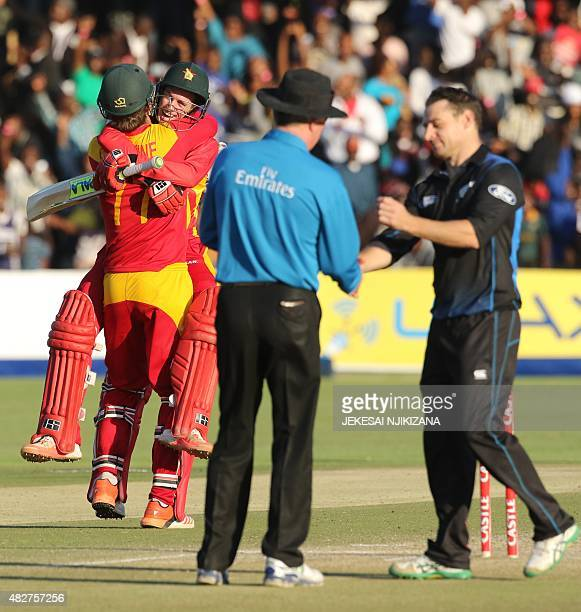 Zimbabwe's players Craig Ervine and Sean Williams embrace after victory during the first game in a series of three One Day International cricket...