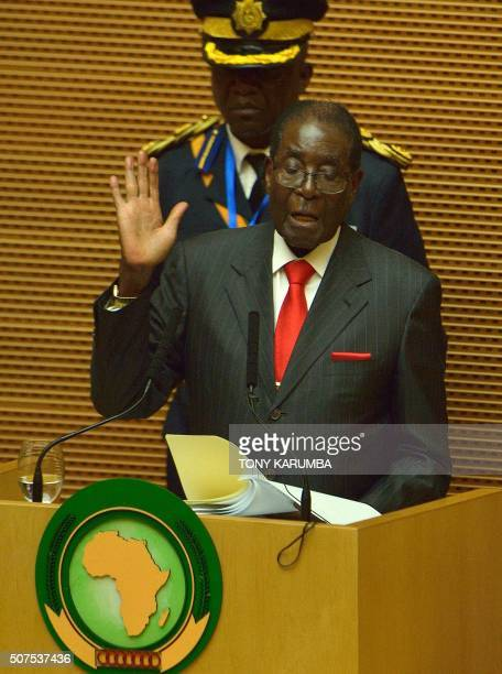 Zimbabwe's President and outgoing African Union chairman Robert Mugabe gestures as he gives an address to the 26th presidential summit of the African...