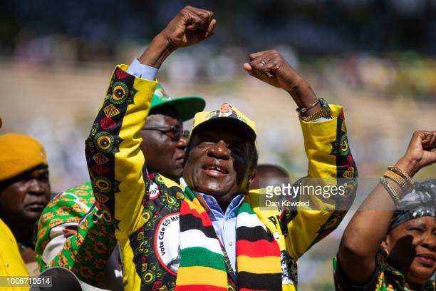 Zimbabwe's President Emmerson Mnangagwa arrives for his closing presidential campaign at the National Sports Stadium during his final 'Zimbabwe...