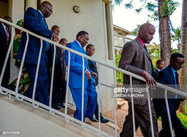 Zimbabwe's President Emmerson Mnangagwa flanked by his deputy Constantino Chiwenga the former army chief who led November's takeover leaves after a...