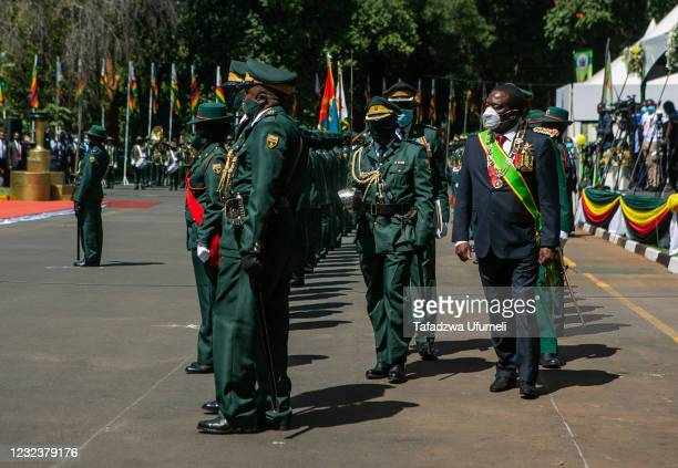 Zimbabwe's president Emmerson Mnangagwa inspects the guard of honour during the Independence Celebrations on April 18, 2021 in Harare, Zimbabwe....