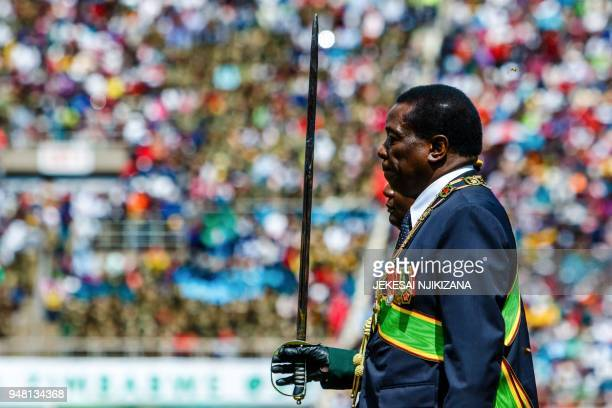 Zimbabwe's President Emmerson Mnangagwa inspects the military guard of honour during Independence Day celebrations at the National Sports Stadium on...