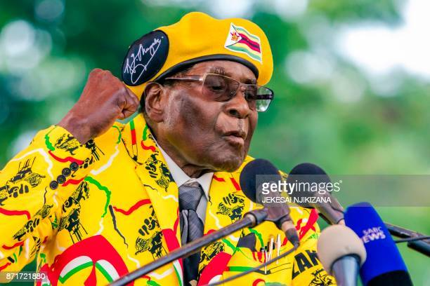Zimbabwe's President Robert Mugabe addresses party members and supporters gathered at his party headquarters to show support to Grace Mugabe becoming...