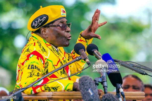 Zimbabwe's President Robert Mugabe addresses party members and officials gathered at his party headquarters to show support to Grace Mugabe becoming...