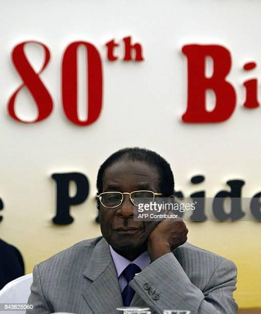 Zimbabwe's President Robert Mugabe celebrates his 80th birthday in his hometown of Zvimba 21 February 2004 Zimbabwe's longserving President Robert...